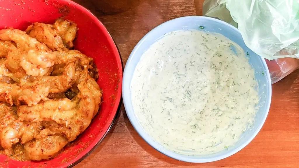 shrimp next to cilantro lime crema