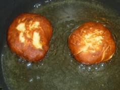 Hanukah Sufgniyot frying in a saucepan