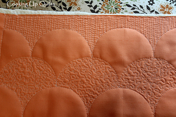 Clamshell quilting with ruler and micro stippling