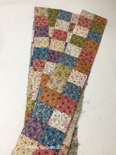 Four patch border jelly roll race quilt