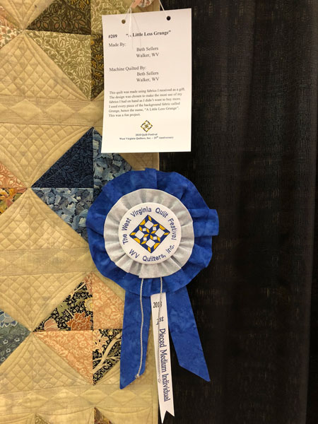 blue ribbon half square triangle quilt