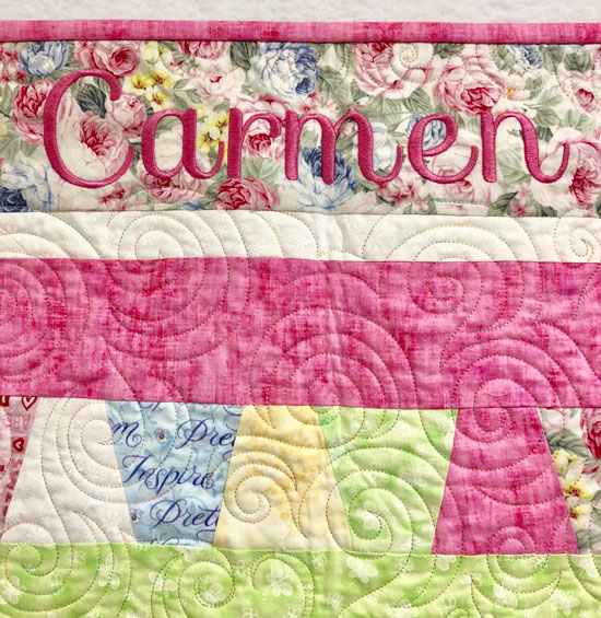 Embroidered name on baby quilt