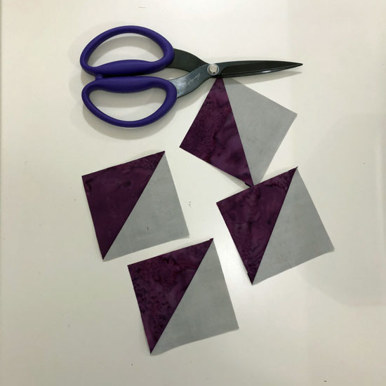 Half Square Triangles with batik and aged muslin