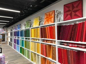 Color wall at Bolts and Quarters Quilt Shop