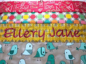 Personalized baby quilt with embroidered name by Beth Sellers of Cooking Up Quilts