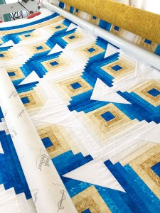 Radiant log cabin quilt