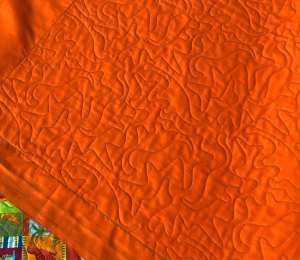Dinosaur quilt quilted by Beth Sellers of Cooking Up Quilts