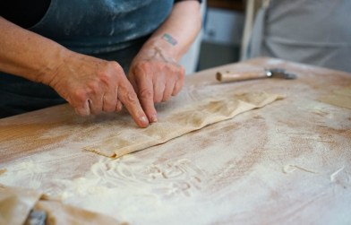 Pressing to remove air from the freshly-made chestnut flour ravioli