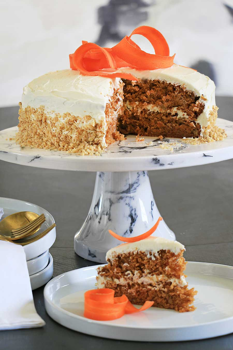 Vegan carrot cake with a slice