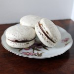 Vanilla Bean Macarons with Dark Chocolate Amaretto Ganache Filling