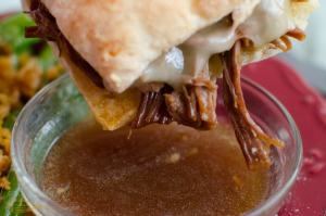 Instant Pot French Dip Sandwiches are sandwiches made from shredded beef with melted cheese served on toasted chibatta rolls and dunked in the flavorful Au Jus just before eating.