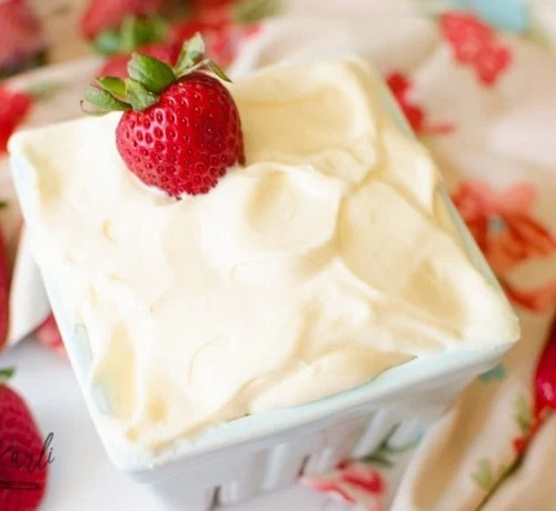Cheesecake Fruti Dip served with a side of strawberries.