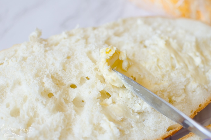 garlic and butter are combined and then spread onto the french bread halves.