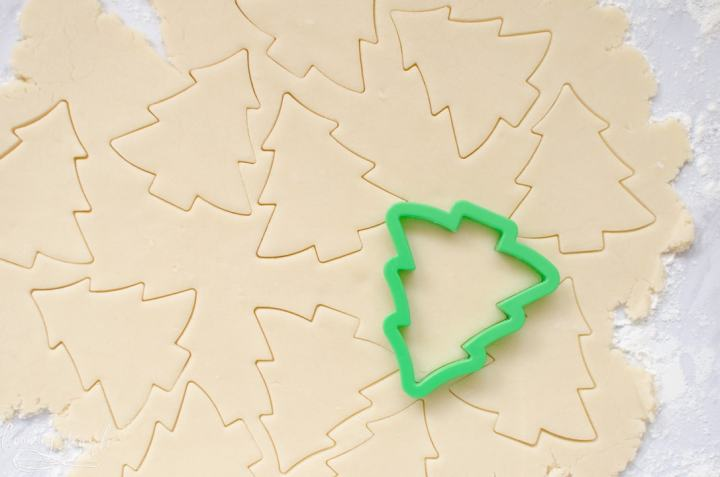 sugar cookie dough rolled out and cut with a Christmas tree