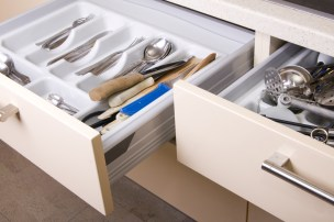 two Open Organized Kitchen Drawers with utensils