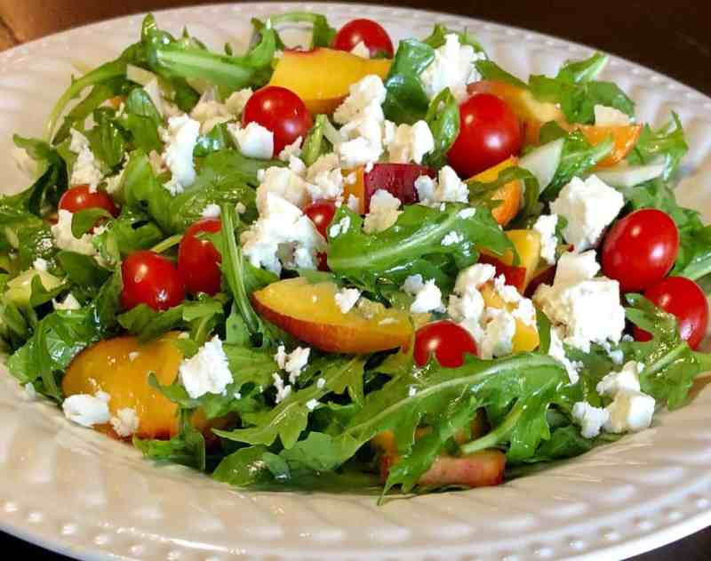 fennel and nectarine salad on fancy white plate