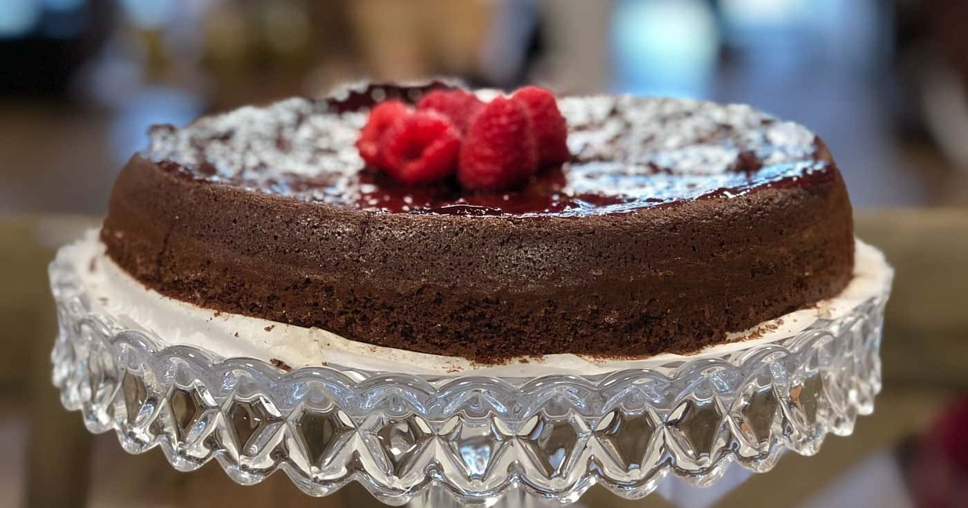 Photo of Dark Chocolate Olive Oil Cake on cake stand