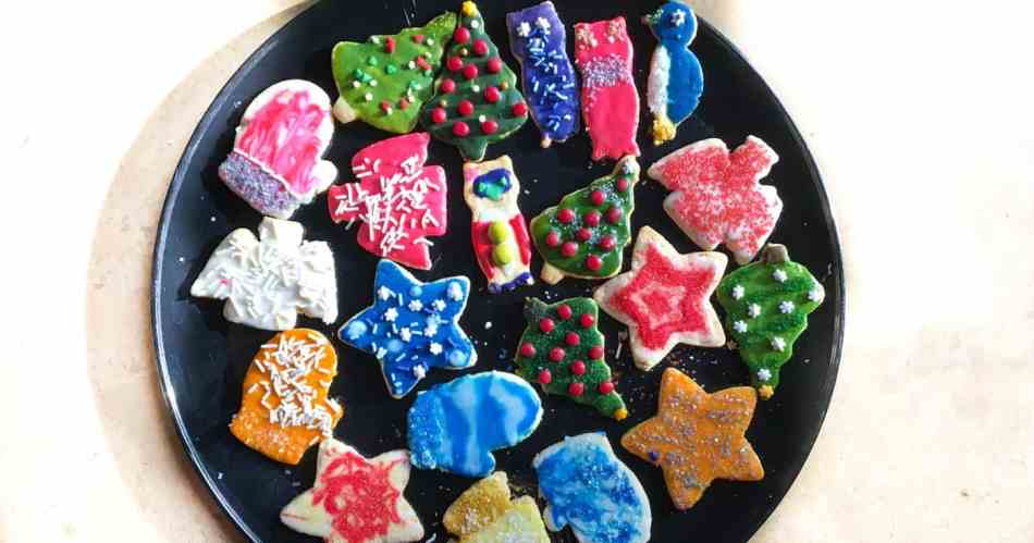 Almond Flour Sugar Cookies decorated for the holidays with icing and sprinkles