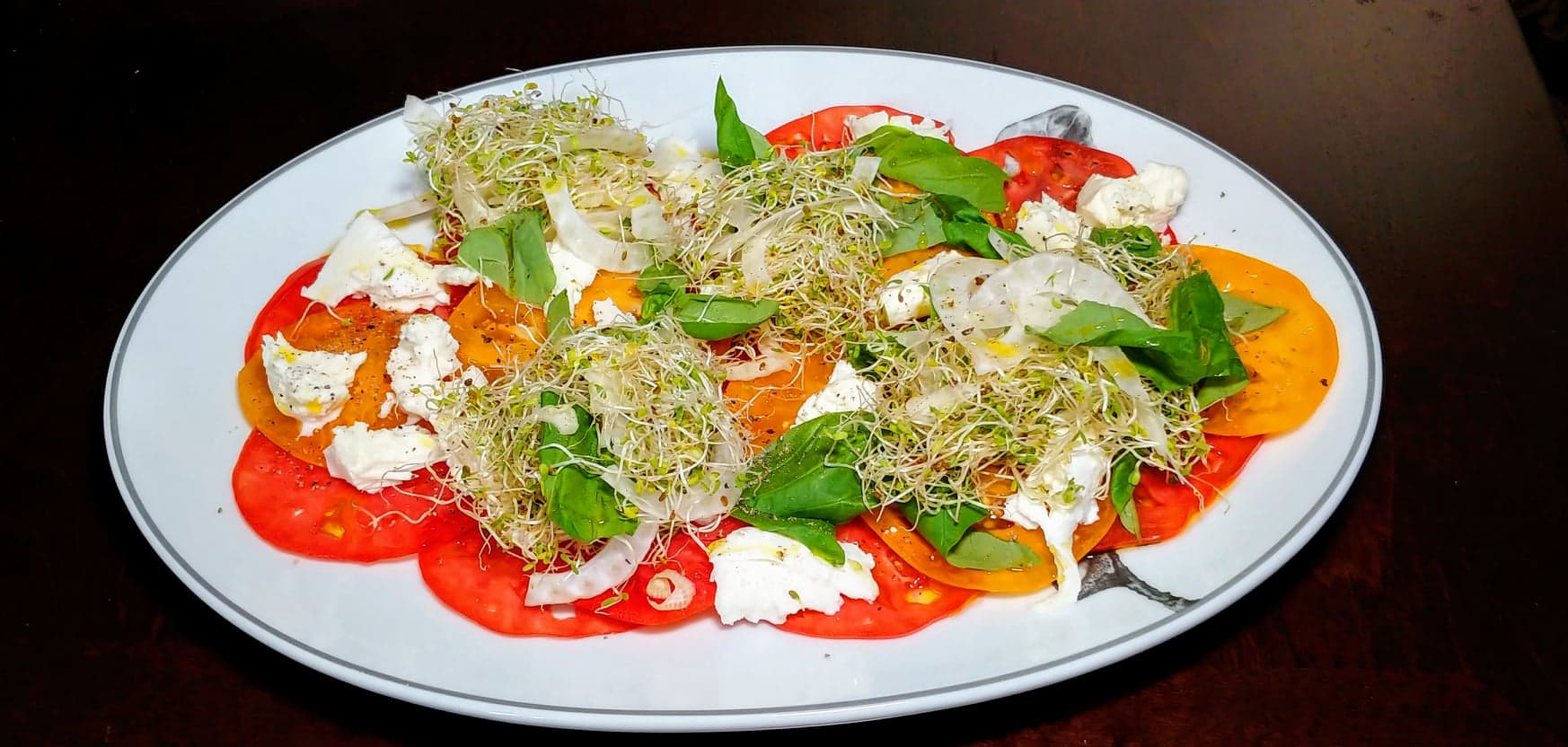 Tomato carpaccio with fennel , alfalfa sprouts and basil  vinaigrette