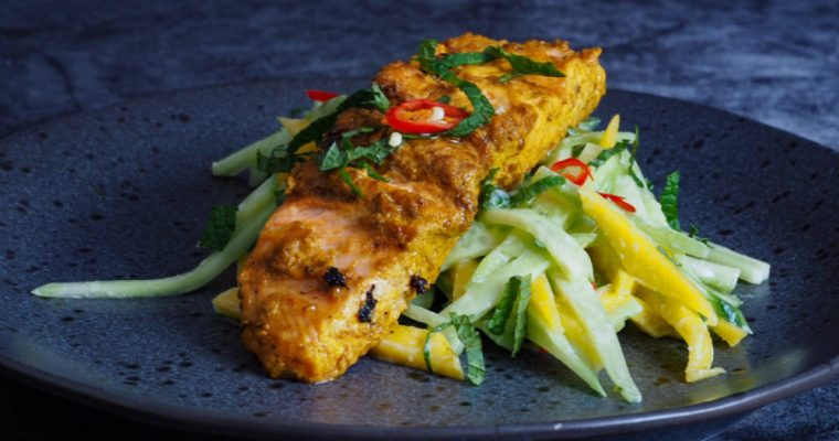Grilled Turmeric salmon with mango and cucumber salad