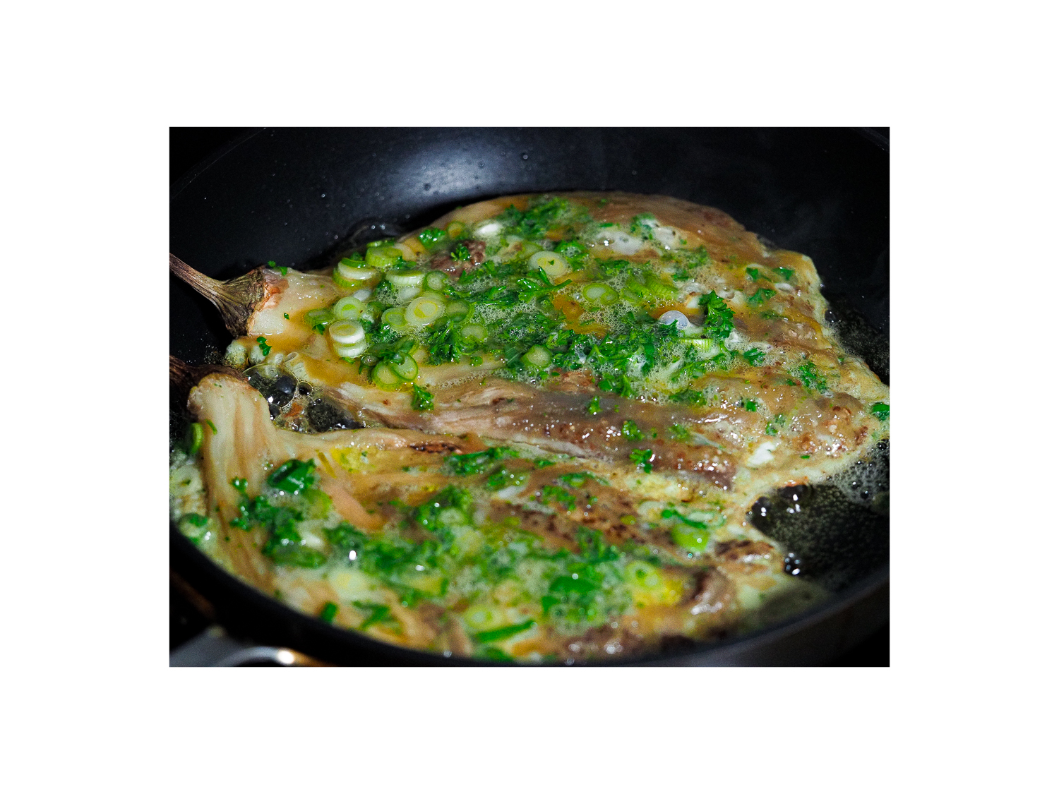 Cooking eggplant omelette in a pan.