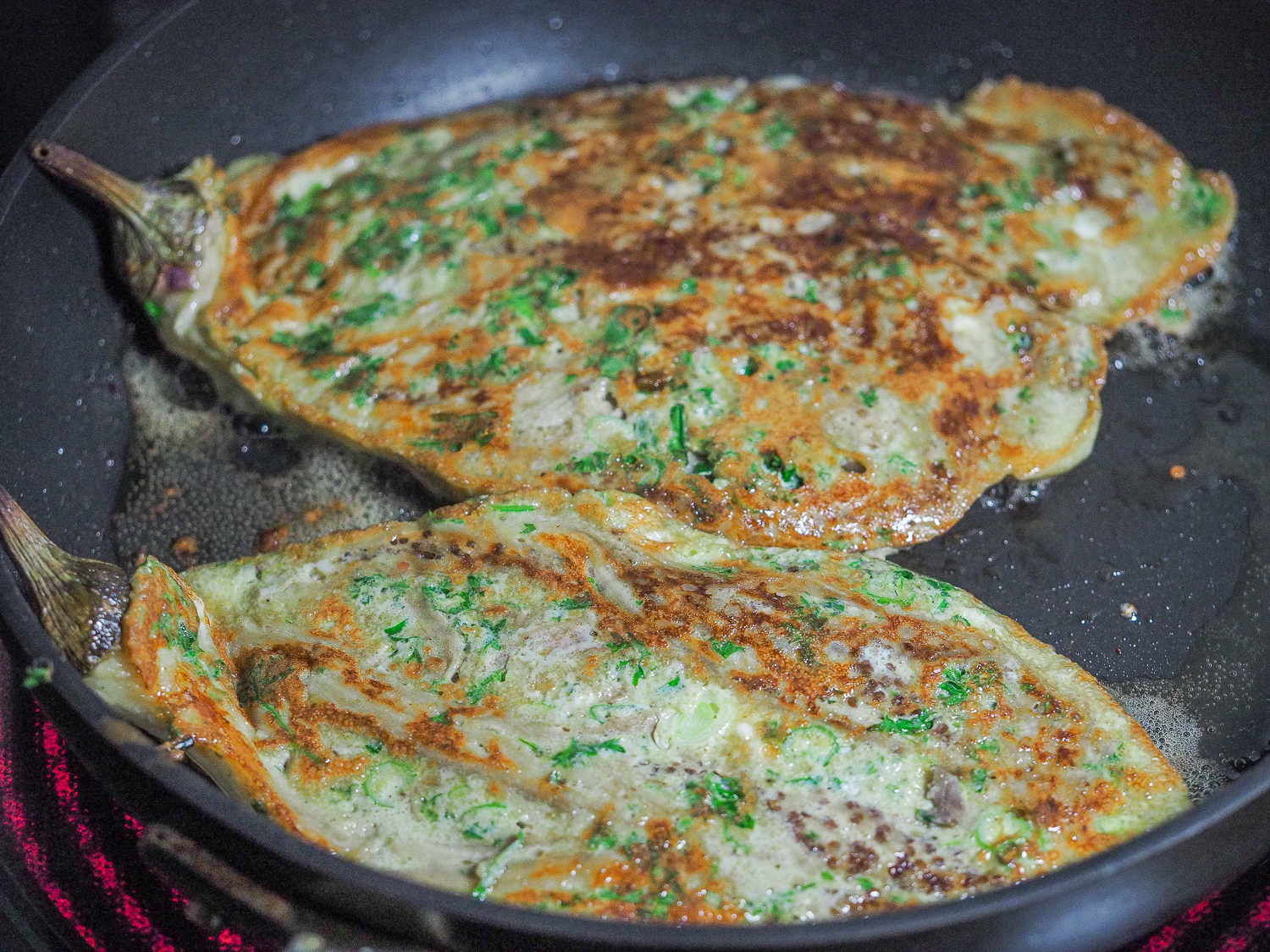 Cooked eggplant omelette in the pan