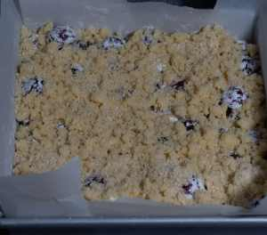 Raw cherry shortbread bars top with cherries and covered the remaining short bread dough
