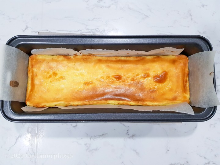 cheesecake in baking pan lined with parchment paper