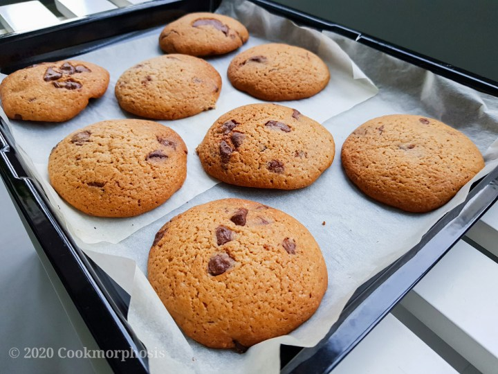 rich and chewy cookies with crispy crust lined on baking sheet