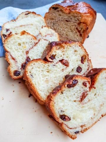 cinnamon raisin bread with dark brown crust and soft texture