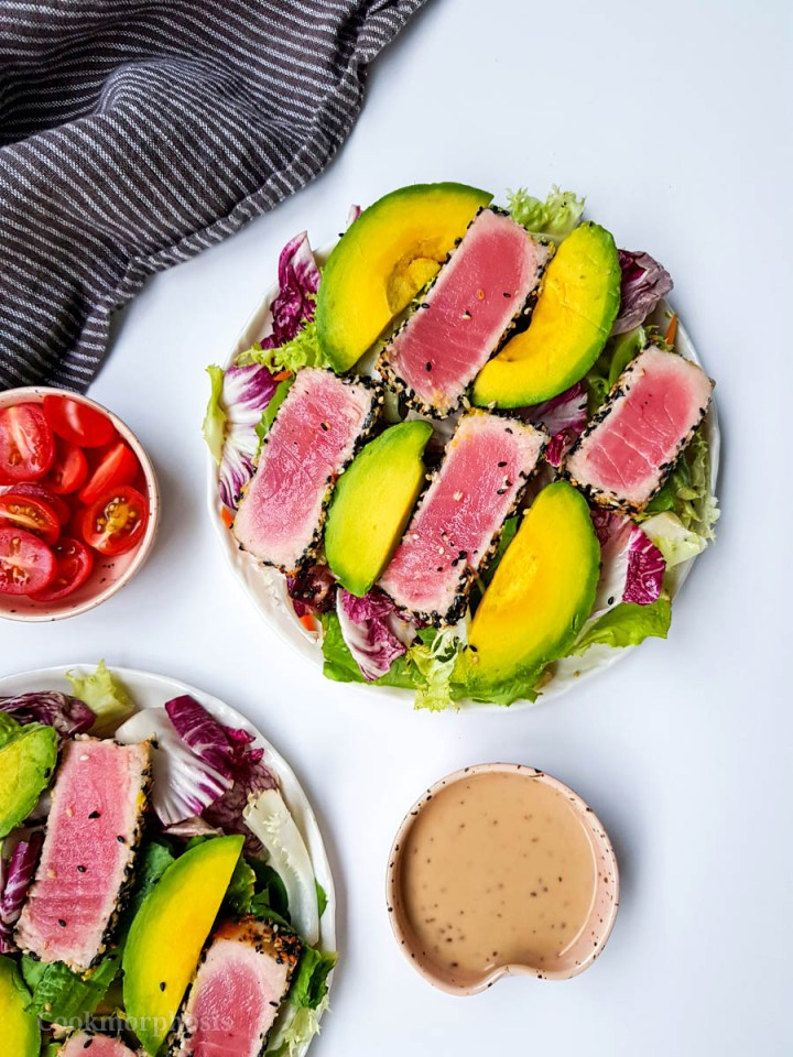 Tuna avocado salad served with creamy ginger dressing and cherry tomatoes
