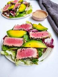 sesame crusted pan seared tuna salad with fresh avocado and vegan ginger dressing