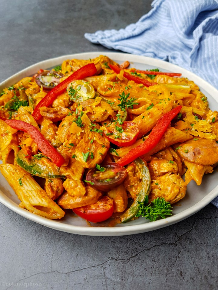 tasty cajun chicken penne pasta cooked with smoked sausages, bell pepper, cherry tomatoes and garnished with parsley