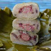 glutinous rice banana cakes cut into slices and stacked over banana leaves