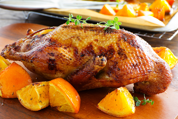Roast duck with pumpkin and oranges.