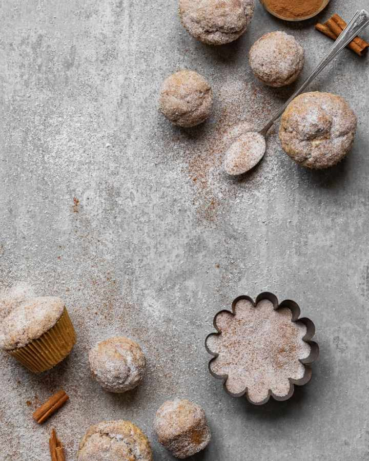 muffins on gray surface with antique spoon