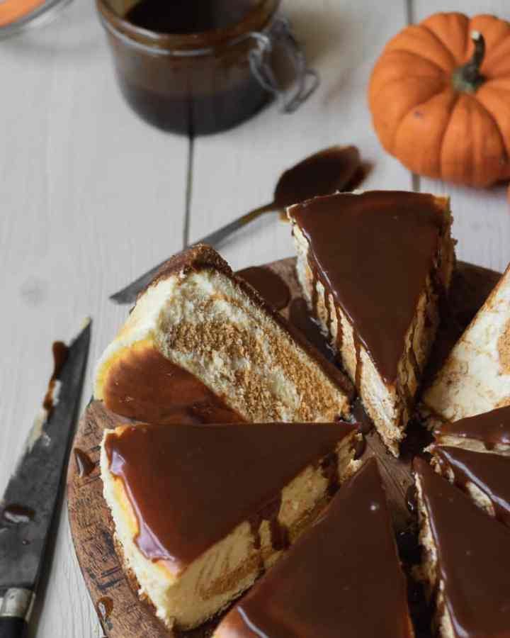 pumpkin swirl cheesecake on cutting board