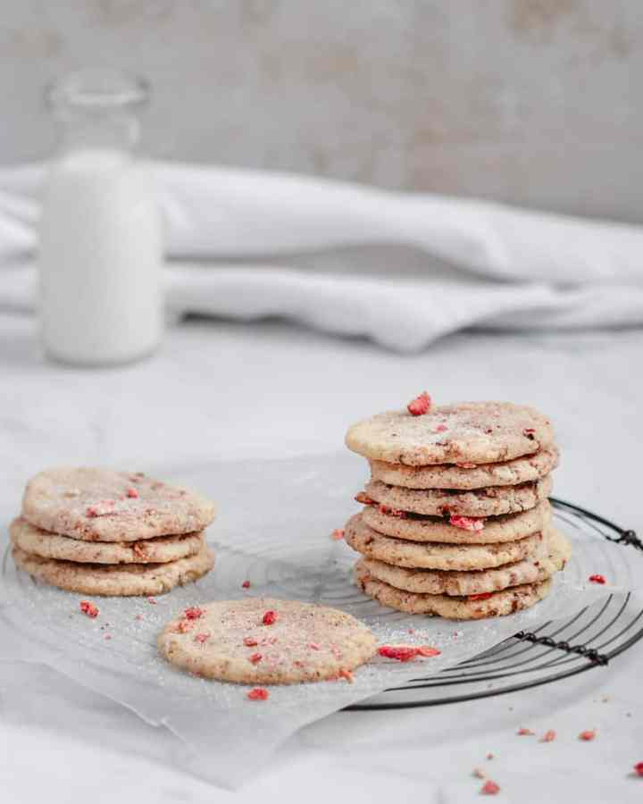 crisp and chewy strawberry sugar cookies on cooling rack