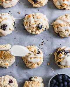 spoon drizzling glaze on easiest scones