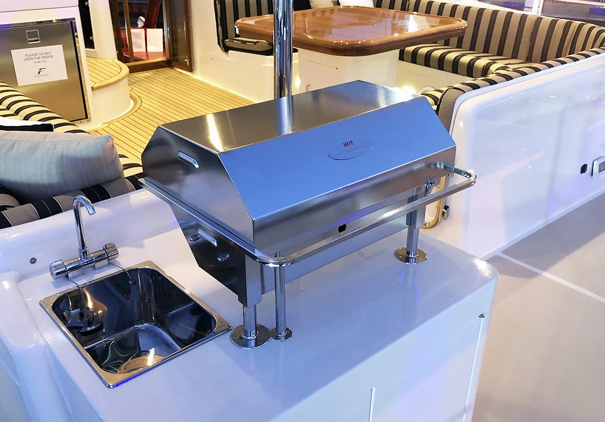 Compact electric stainless Cookout BBQ boat barbecue on Fleming Yacht