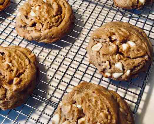 peanut butter white chocolate cookies on baking rack
