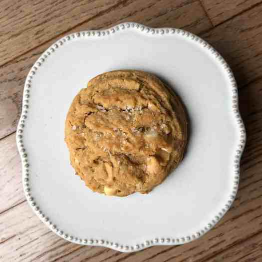 peanut butter cookie with white chocolate and peanut butter chips on cookie plate