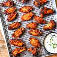 Sheet pan with Sweet and Smoky Dry Rub Wings and Ranch Dressing