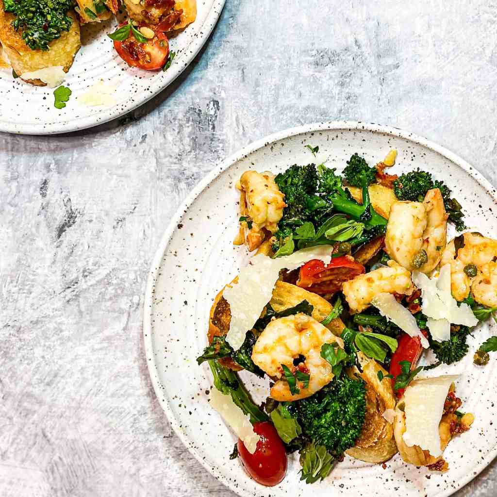 Small plates of Mediterranean Shrimp with broccoli rabe and crostini
