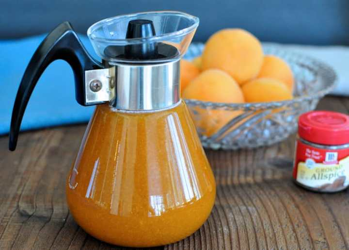 Homemade Apricot Syrup with a bowl of fresh apricots
