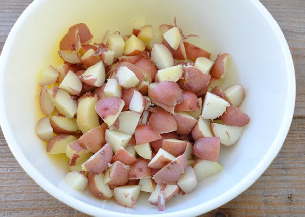 cut up cooked red potatoes in a bowl