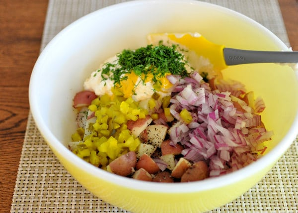 potatoes, onions, pickles, mayo, parsley, in a large bowl