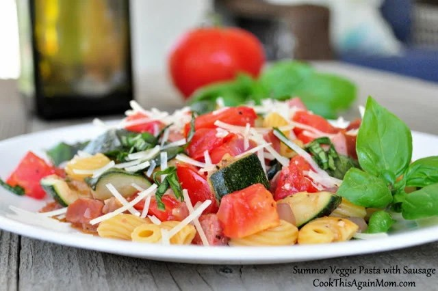 Summer Veggie Pasta with Sausage sitting on a white plate