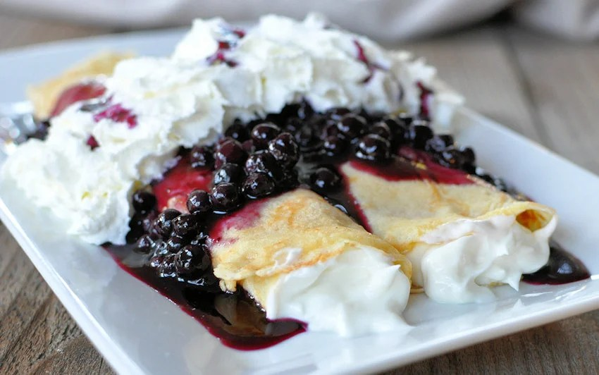 Crepes Smothered in Blueberry Sauce