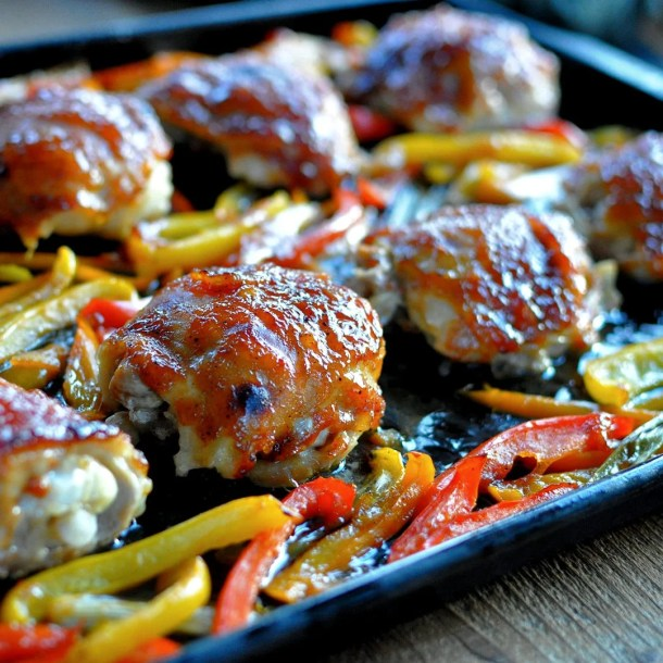 baked sweet and sour chicken thighs on a baking sheet